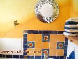 Gäste-WC mit Sonnenfliesen